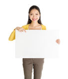 Asian woman holding white paper card Stock Images