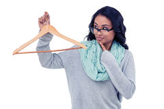 Asian woman holding wooden hanger Royalty Free Stock Image