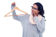 Asian woman holding wooden hanger Stock Photography