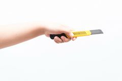 Asian woman holding a yellow box cutter knife Royalty Free Stock Photo