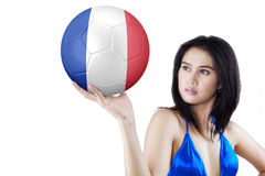 Asian woman holds ball with flag of France Royalty Free Stock Photos