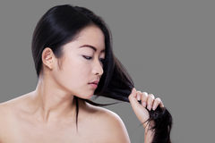 Asian woman holds her hair Royalty Free Stock Photos