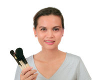 Asian woman holds make up brushes Stock Photography