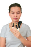 Asian woman holds make up brushes Royalty Free Stock Image