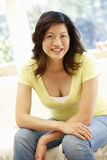 Asian woman at home Royalty Free Stock Image