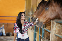 Asian woman and horse Stock Photo