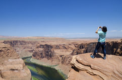 Asian woman horseshoe bend. An asian woman taking pictures at the horseshoe bend Stock Images