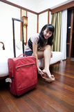 Asian woman in a hotel room Stock Photo