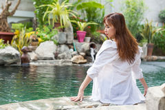 Asian Woman In Hotel Swimming Pool Relaxing Vacation Travel, Young Girl Enjoying Spa Royalty Free Stock Photography
