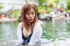 Asian Woman In Hotel Swimming Pool Relaxing Vacation Travel, Young Girl Enjoying Spa. Exotic Paradise Resort Royalty Free Stock Photo