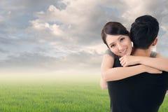 Asian woman hug her boyfrien Royalty Free Stock Image