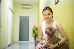 Asian woman hug Miniature Poodle Stock Images