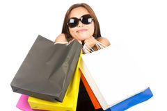 Asian Woman Hugging Department Store Bags Close H. An attractive Asian woman shopper smiling and wearing stylish sunglasses while playfully hugging colorful Stock Images