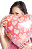 Asian woman hugging heart-shaped balloon royalty free stock photography