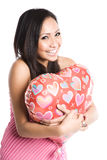 Asian woman hugging heart-shaped balloon Stock Images