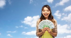 Asian woman with hundred euro money banknotes. People, ethnicity and portrait concept - happy asian young woman holding hundreds of euro money banknotes over royalty free stock photos
