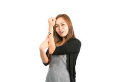 Asian Woman Indicating Time Pointing At Watch Stock Photography