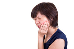 Asian woman in intense toothache pain with hands over face. With white background Stock Photo