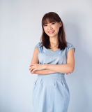 Asian woman isolated on blue background. Stock Photo