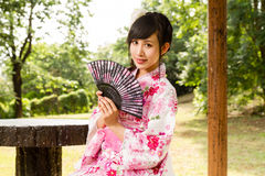 Asian woman in Japanese garden Stock Images