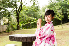 Asian woman in Japanese garden Stock Photography