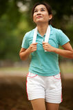 Asian woman jogging in the park . . Stock Photography
