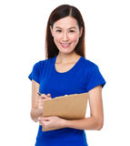 Asian woman jot note on clipoard Stock Photos