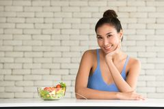 Asian woman in joyful postures with salad bowl on the side stock images