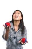 Asian woman and juggling balls Royalty Free Stock Photos