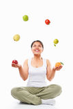 Asian woman juggling fruits Royalty Free Stock Photography
