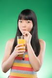 Asian woman and juice Royalty Free Stock Image