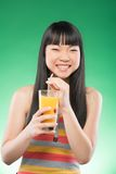 Asian woman and juice Stock Images