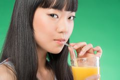 Asian woman and juice Royalty Free Stock Photos