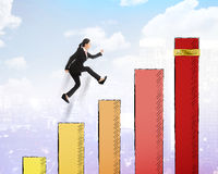 Asian woman jump on the chart Stock Photo