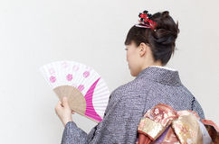 Asian woman in a kimono Royalty Free Stock Image
