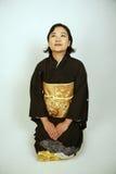 Asian woman in a kimono Royalty Free Stock Photos