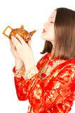 Asian woman in kimono drinking Chinese tea Royalty Free Stock Photography