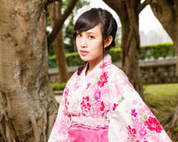 Asian woman in kimono in garden Royalty Free Stock Photography