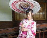 Asian woman in kimono holding umbrella Royalty Free Stock Photos
