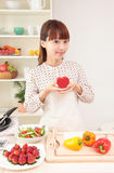 Asian woman in kitchen Stock Photos