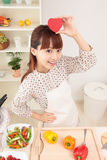 Asian woman in kitchen royalty free stock photography