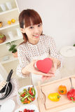 Asian woman in kitchen stock image
