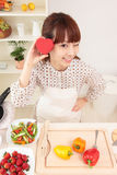 Asian woman in kitchen royalty free stock image
