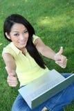 Asian Woman on Laptop Computer Royalty Free Stock Photos