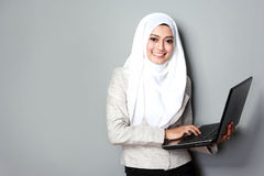 Asian woman with laptop Stock Photo