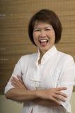 Asian woman laughing. Beautiful mature Asian woman laughing Royalty Free Stock Photo