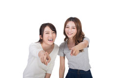 Asian woman laughing and pointing. Asian women laughing and pointing, closeup portrait Royalty Free Stock Photography