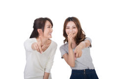 Asian woman laughing and pointing. Asian women laughing and pointing, closeup portrait Stock Photography