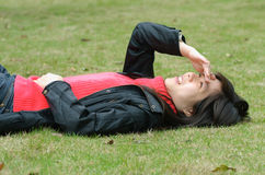 Asian woman on lawn Stock Image