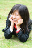 Asian woman on lawn Royalty Free Stock Photos